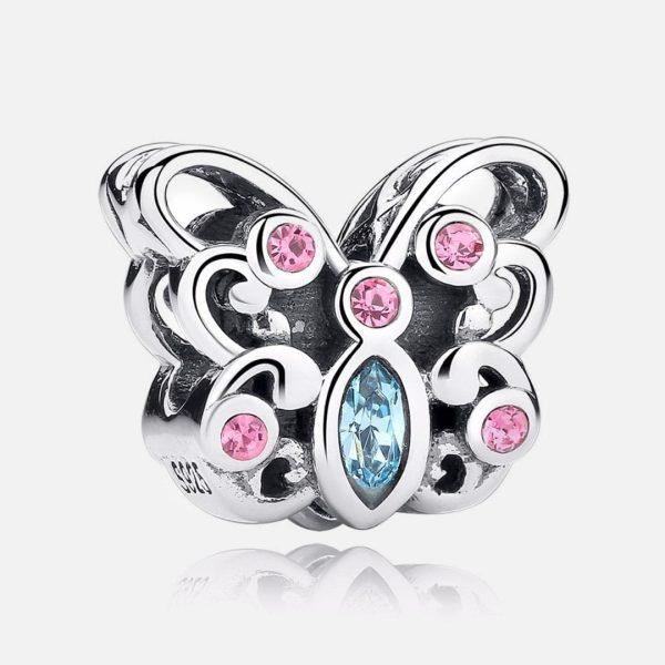 Ezüst pillangó charm kék kővel